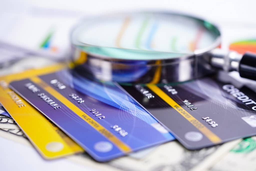 Credit card with Magnifying glass : Financial development, Accounting, Statistics, Investment Analytic research data economy office Business company banking concept.