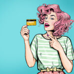 woman showing credit card.